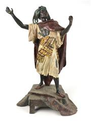 Sale 8995H - Lot 36 - A cold painted metal figure of a proselytising Moor, signed Waagen, height 55cm