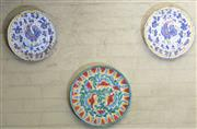 Sale 8550H - Lot 241 - Three hand painted wall plates in Spanish style, largest diameter 40cm