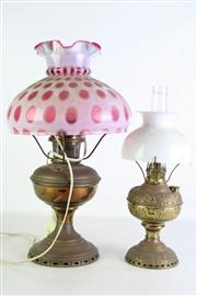 Sale 8931B - Lot 609 - brass kerosene lamp with cranberry glass shade t/w a smaller white shaded example