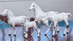 Sale 9103M - Lot 466 - A group of four Beswick white and grey glazed ceramic horses, tallest Height 16cm