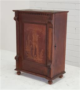 Sale 9179 - Lot 1041 - Late 19th Century German Oak & Walnut Table Top Smokers Cabinet, the single door with pressed decoration of a 17th century pipe smo...
