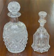 Sale 8346A - Lot 46 - A crystal barrel shaped decanter with silver collar, H 27cm, with a Victorian decanter