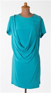 Sale 8550F - Lot 135 - A 100% silk Gary Bigeni short sleeve top in brilliant sky blue with draping to front, size 3.