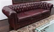 Sale 8782A - Lot 105 - A Chesterfield three seater lounge chair in oxblood red by Casamia. Width 233 90 x 74cm