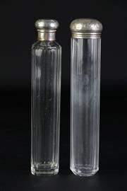 Sale 8897 - Lot 94 - English Hallmarked Sterling Silver Topped Pair of Crystal Perfume Bottles (length 18cm, weight of lids: 17.5g)