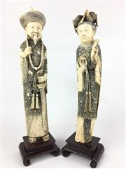 Sale 8995H - Lot 38 - A pair of ivory emperor and empress figures on wooden stands with elaborately carved robes, height of tallest 37cm