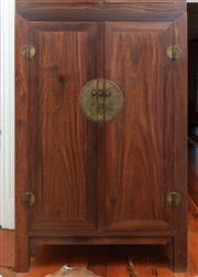 Sale 9020H - Lot 78 - A Chinese Ironwood and brass two door cabinet with four drawers and shelved interior H-180xW-120xD59cm