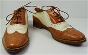 Sale 8460F - Lot 21 - A pair of caramel and arctic white leather Ralph Lauren wingtips, light wear, size 8B