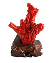 Sale 8536 - Lot 100 - Chinese red coloured coral ornament raised on timber stand, H17cm
