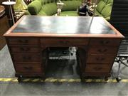 Sale 8805 - Lot 1040 - Leather Top Desk with Nine Drawers