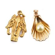 Sale 8846 - Lot 305 - TWO 9CT GOLD CHARMS; a shell set with a 6.5mm round golden cultured pearl, other a 9ct gold Laotian 3 headed elephant, total wt. 3.66g.