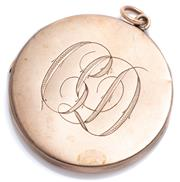 Sale 9046 - Lot 357 - AN ANTIQUE AUSTRALIAN 9CT ROSE GOLD LOCKET; 42mm round locket pendant engraved with CD monogram opening to double locket, back with...