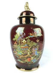 Sale 8995H - Lot 40 - A Rouge Royale Crown Devon lidded urn with an oriental scene to body and dog of foo finial, character mark to base 4total height 36cm