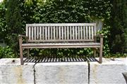 Sale 9087H - Lot 238 - A teak bench with weathered patina. 1.8m width
