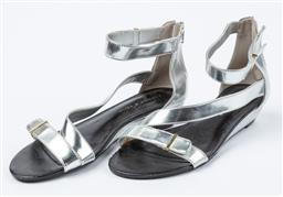 Sale 9027F - Lot 47 - A pair of Charles and Keith low wedge sandals in silver, size 38.