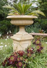 Sale 9080H - Lot 1 - A concrete urn form planter and pedestal with a cycad, Height of plinth 73cm x Height of planter 54cm x Diameter 79cm