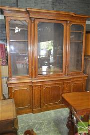 Sale 8267 - Lot 1073 - Late Victorian Oak Breakfront Bookcase, with three glass panel doors (centre pane cracked), flanked by columns, with three panel doo...