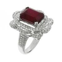 Sale 8221A - Lot 106 - 18ct White Gold Ruby and Diamond Cocktail Ring; centering a step cut ruby estimated at 7.23ct,  to a surround brilliant cut and tape...