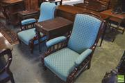 Sale 8390 - Lot 1042 - Pair of Late Victorian Walnut Armchairs with blue scale upholstery and turned galleries.