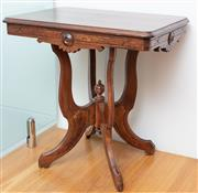 Sale 9044H - Lot 101 - A Victorian walnut parlour table with carved apron on quadraped base presenting a finial to centre circa 1890, made in the USA, Heig...