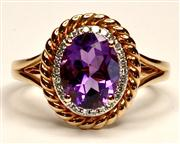 Sale 8036A - Lot 311 - AN 18CT ROSE GOLD CLUSTER RING; centring an oval amethyst to a surround of 26 single cut diamonds within a rope border. Size N.