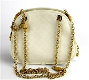 Sale 8134B - Lot 389 - A GUCCI MONOGRAM BAG; cream material with gold metal and bamboo chain and internal tag no. 007.115.0171, width 21cm.