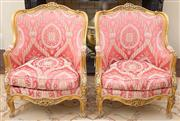 Sale 8470H - Lot 16 - A Louis XV style carved gilt salon suite comprising a three seater settee and two fauteuils, upholstered in gold thread and salmon I...