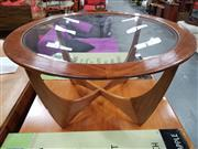 Sale 8705 - Lot 1028 - G Plan Atmos Circular Teak Coffee Table with Glass Top
