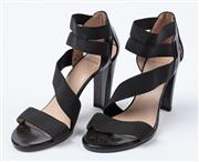 Sale 9027F - Lot 77 - A pair of Stuart Weitzman Elastic strappy heels in black, size 38.