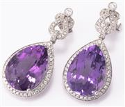 Sale 9066A - Lot 59 - A PAIR OF 18CT WHITE GOLD AMETHYST AND DIAMOND EARRINGS; each set with a pear cut amethyst to border and lyre shape surmount set wit...