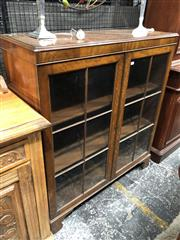 Sale 8693 - Lot 1025 - Mahogany Bookcase,  with two astragal doors & bracket feet (key in office)