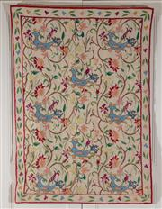 Sale 9020H - Lot 85 - An Eastern European embroidered wall hanging depicting mythical bird in a floral surround H146x102cm