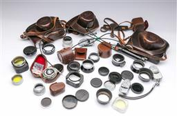 Sale 9098 - Lot 43 - A Collection Of Leica Camera Parts, Accessories And Cases