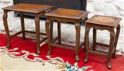 Sale 9164H - Lot 34 - A set of three graduating carved nesting tables, each with carved details. Height of tallest 36cm