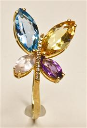 Sale 8036A - Lot 338 - AN 18CT GOLD MULTI GEM SET RING; set with a marquise cut amethyst, blue topaz, rose quartz and a citrine around a row of 12 single c...
