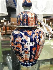 Sale 8635W - Lot 56 - Lidded Vessel With An Imari Pattern (H:37cm)- Crack To Inside Rim Of Lid