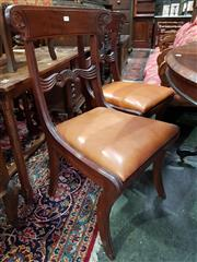 Sale 8774 - Lot 1080 - Set of Four Regency Mahogany Chairs, with carved top & back rail, tan leather drop-in seats & on sabre legs
