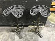 Sale 8787 - Lot 1001 - Pair of Cast Iron Mounted Tractor Seats