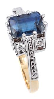 Sale 9066A - Lot 62 - AN 18CT GOLD SAPPHIRE AND DIAMOND RING; 6 claw set with an emerald cut blue sapphire of approx. 1.7ct with 2 round brilliant cut dia...