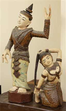Sale 9164H - Lot 35 - Two carved teak painted and mirror embellished dancer figures, damage to extremities, (envelope with missing tips of fingers include...