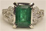 Sale 8036A - Lot 323 - AN EMERALD AND DIAMOND RING; centring a step cut emerald estimated as 2.38ct to split shoulders set with 70 round brilliant cut diam...