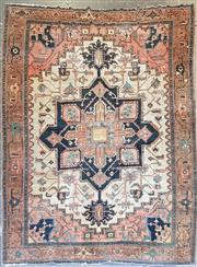Sale 9014 - Lot 1073 - Antique Persian Heriz Wool Carpet, the pink & black central octagon with lotus pendants,  the border with alternate facing flowers (...