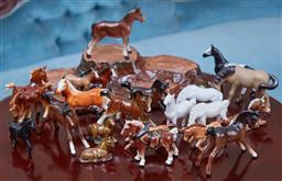 Sale 9103M - Lot 471 - A shelf lot of ceramic miniature horses.