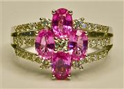 Sale 8036A - Lot 351 - A SAPPHIRE AND DIAMOND CLUSTER RING; set in 18ct white gold with 4 pink sapphires totalling approx. 2.00ct surrounded by 35 round br...