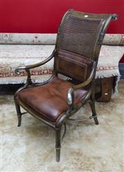 Sale 8205 - Lot 68 - A contemporary Maitland double caned and leather upholstered armchair, with bamboo effect uprights and metal cross stretcher and scr...
