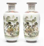 Sale 8716A - Lot 99 - A pair of Chinese rouleau vases, each depicting traditional village landscapes, each height 28cm with markings to base