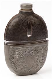 Sale 9048A - Lot 41 - A pewter and leather cased glass hip flask with engraved design surrounding vacant sheid, Height 16cm