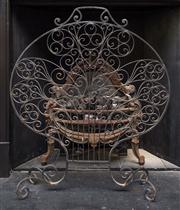 Sale 8222 - Lot 62 - A wrought iron scroll work spark screen, H 89cm Film Provenance; Australia, 2008