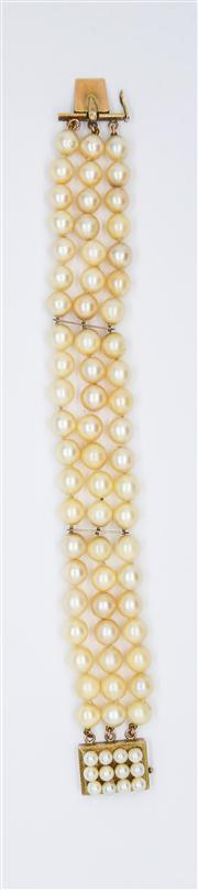 Sale 8250 - Lot 63 - A THREE ROW PEARL BRACELET; composed of 63 cultured pearls, 7 - 7.3mm round of cream colour with good lustre, 2 spacing bars to a bo...