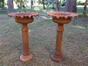 Sale 8579 - Lot 32 - A pair of cast iron planters with surface rust, H 80 X 40cm
